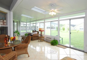 inside-sunrooms-interior-with-rattan-furniture-and-ceiling-fans-with-lights