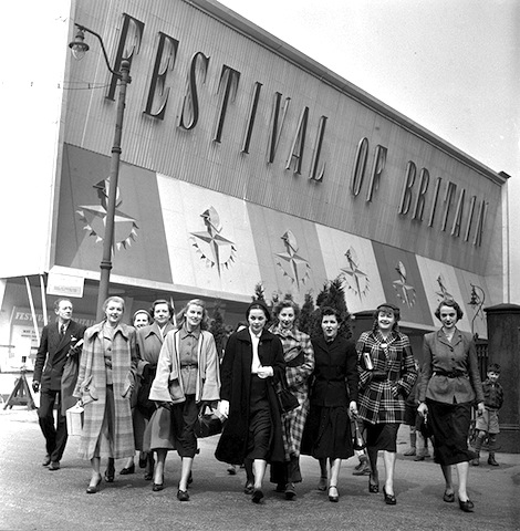 England. 1951. Fashion models performing in the Festival of Britain's Travelling Exhibition are pictured outside the venue.